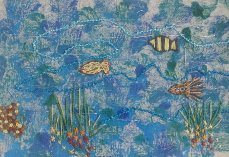Embroidered fish on printed fabric