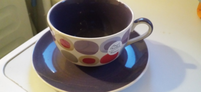 Large purple cup and saucer