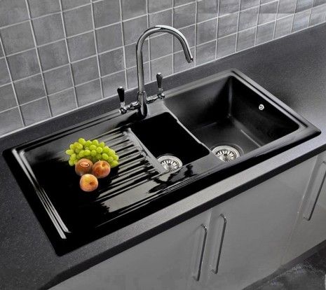 Black ceramic 1.5 bowl sink with fruit on drainer