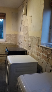 Kitchen appliances in an undecorated room