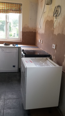 New kitchen units in a newly plastered room