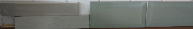 Sage green tiles leaning against wall