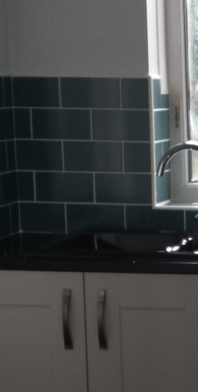Duck egg tiles in a grey kitchen