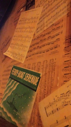Sheet music used to paper a wall