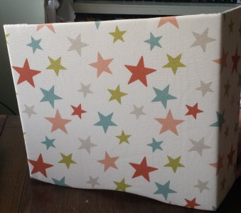 Padded pelmet sample in white fabric with stars