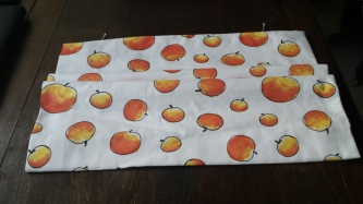 Roman blind in white fabric with a peach design
