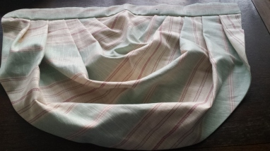 Curtain swag in a green and pink fabric