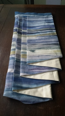 Curtain tail in blue horizontal striped fabric