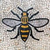Yellow and black bee in mosaic form