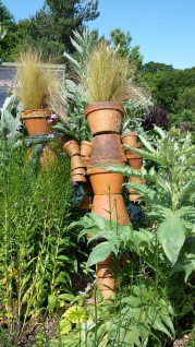 Flowerpots made into men with grass hair
