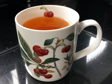 Mug with redcurrants design containing Earl Grey tea with no milk