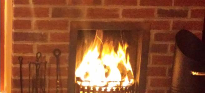 Open fire in a brick fireplace