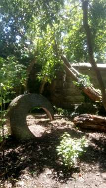 2 large garden ornaments in a wooded area