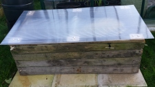 Cold frame made with pallet wood and plastic sheet lid