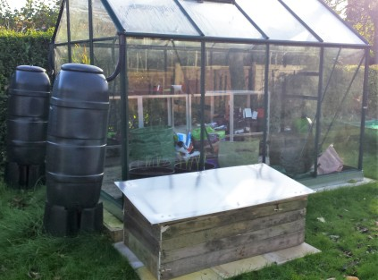 Greenhouse with 2 water butts and cold frame outside
