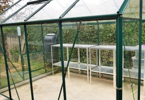 Empty greenhouse with aluminium staging