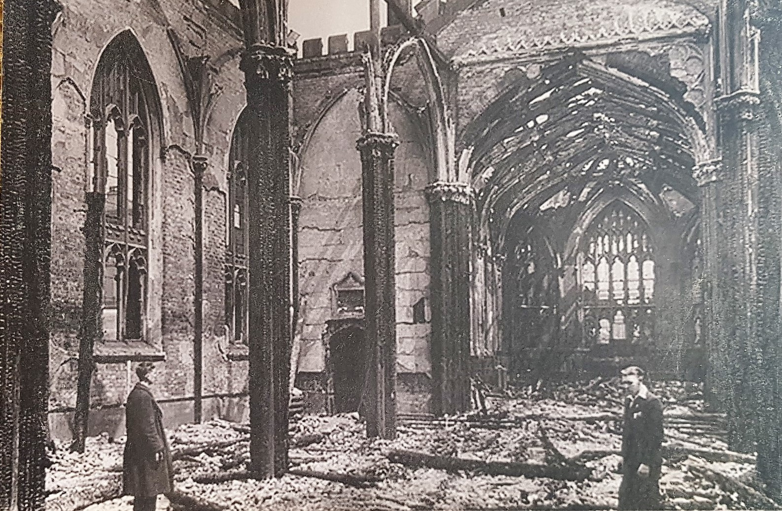 Black and white photo of a bombed church interior